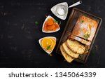 orange cake with dried apricots ... | Shutterstock . vector #1345064339