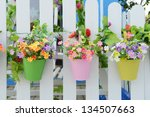 hanging flower pots with fence | Shutterstock . vector #134507663