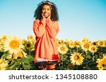 happy young black woman walking ... | Shutterstock . vector #1345108880