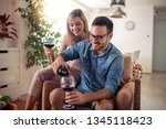young loving couple drinking... | Shutterstock . vector #1345118423