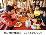 group of asian friends making... | Shutterstock . vector #1345147109