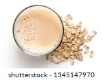 glass of oat drink  next to a... | Shutterstock . vector #1345147970