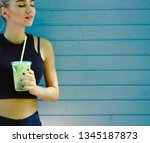 blond hair woman drinking a... | Shutterstock . vector #1345187873