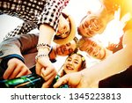 group of young friends in a... | Shutterstock . vector #1345223813