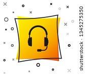 black headphones with...   Shutterstock .eps vector #1345275350