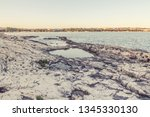 wild stony beach. blue sea  | Shutterstock . vector #1345330130