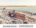 wild stony beach. blue sea  | Shutterstock . vector #1345330133