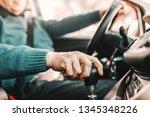 close up of senior man holding... | Shutterstock . vector #1345348226
