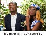 beautiful happy couple sitting... | Shutterstock . vector #1345380566