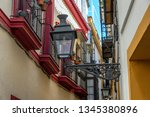 old street light in a narrow... | Shutterstock . vector #1345380896
