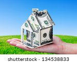 house made of money in hand on... | Shutterstock . vector #134538833