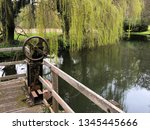 rusty metal wheel on wodden... | Shutterstock . vector #1345445666
