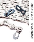 Small photo of Jan 10, 2019 Bila Tserkva, Ukraine. Bike chain with Master Link or missing link with powerlock isolated on white background. Wippermann is a roller chain manufacturer located in Germany.