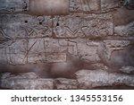 hieroglyph texture from egypt... | Shutterstock . vector #1345553156