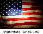 closeup of grunge american flag   Shutterstock . vector #1345573559