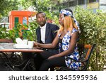 young african couple sitting in ... | Shutterstock . vector #1345595936