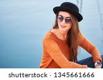 portrait of young stylish girl... | Shutterstock . vector #1345661666