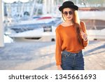 portrait of young stylish girl... | Shutterstock . vector #1345661693