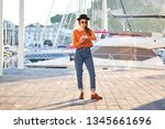 young stylish girl wearing... | Shutterstock . vector #1345661696