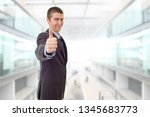 happy business man going thumb... | Shutterstock . vector #1345683773
