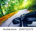 car front mirror driving fast... | Shutterstock . vector #1345722173
