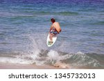 Skim Boarder Going Airborne