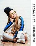a full length portrait of a... | Shutterstock . vector #1345795286