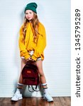 a full length shot of a bright... | Shutterstock . vector #1345795289