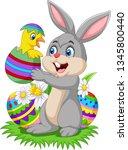cartoon rabbit holding a baby... | Shutterstock .eps vector #1345800440