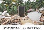 standing door of destroyed... | Shutterstock . vector #1345961420