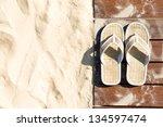 sand and beige flip flops. pair ...   Shutterstock . vector #134597474