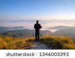 hiker with photo camera... | Shutterstock . vector #1346003393