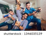 smiling male friends playing...   Shutterstock . vector #1346035139
