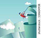 mountaineer climbs on a pike.... | Shutterstock . vector #134604938