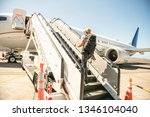 a young traveling man get in...   Shutterstock . vector #1346104040