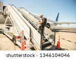 a young traveling man get in...   Shutterstock . vector #1346104046