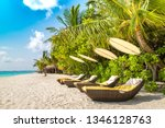 wooden sunbed on tropical beach ... | Shutterstock . vector #1346128763