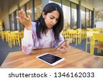 disappointed lady using tablet... | Shutterstock . vector #1346162033