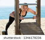young smiling woman doing... | Shutterstock . vector #1346178236
