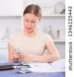 upset woman calculating... | Shutterstock . vector #1346235443