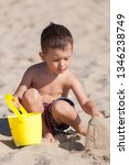 little boy playing with sand on ... | Shutterstock . vector #1346238749