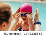 girl wearing swimming goggles...   Shutterstock . vector #1346238866