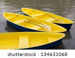 Yellow Row Boats In The Lagoon.