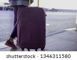 travelling woman with suitcase...   Shutterstock . vector #1346311580