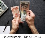 Hands Of An Older Man Counting...
