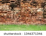 old brick wall and grass in... | Shutterstock . vector #1346371346