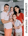 portrait of young happy family... | Shutterstock . vector #1346394329