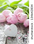 Heart shape with copy space and tulips - stock photo