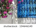 Blue window and flowers - stock photo