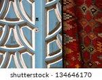 Blue door and carpet in Tunisia - stock photo